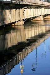 details of a bridge 2 (EllaH52) Tags: bridge river water blue reflections streetlights lampposts ripples