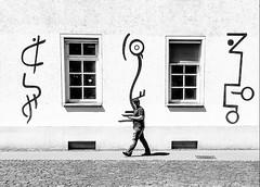 Streetart (A. Yousuf Kurniawan) Tags: streetart streetphotography urbanlife streetlife blackandwhite monochrome minimalism minimalist architecture building cameraphone cameraphonestreet man walking walkway window juxtaposition contrast composition decisivemoment script