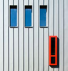 Three blue, one red (jefvandenhoute) Tags: belgium belgië vilvoorde red blue shapes light lightplay lines wall windows geometric structure