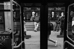 Todd and others (Gary Kinsman) Tags: london fujifilmfinepixx100 candid streetphotography streetlife fujix100 wc2 thestrand aldwych bus waiting walking kingscollegelondon kcl strandcampus advert advertising history lookingout window glass todd bright 2014 people person travel journey bw blackwhite onthemove