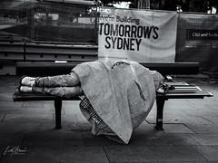 Sydney CBD Juxtaposition (Laith Stevens Photography) Tags: street homeless olympus omd olympusinspired omdem1mkii 25mmf12 zuiko hard juxtaposition olympusaustralia olympusau olympusomd outdoor city streetphotography sydney hardtimes blackandwhite bw