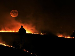 Heat of the Night (whalenbrenda) Tags: fire night moon landscape dark flames dusk sparks dangerous nature person walks sky photography longexposure nightshot nightsky orangehue hue darkness