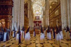 Semana Santa Sevilla Procession (Dick Shaffer) Tags: semanasanta seville sevilla spain penitentes procession andalucia cathedral religion religious catholic capes hoods candles church flickrtravelaward holy