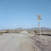 desert crossing. rice, ca. 2018. (eyetwist) Tags: eyetwistkevinballuff eyetwist mojavedesert crossbuck dirtroad railroad tracks crossing vanishingpoint california rice mamiya 6mf 50mm kodak portra 160 ishootfilm analog analogue mamiya6mf mamiya50mmf4l kodakportra160 ishootkodak mojave desert clouds film emulsion mamiya6 square 6x6 mediumformat 120 filmexif iconla epsonv750pro lenstagger highdesert landscape roadsideamerica barren desolate dirt bleak american west newtopographics sign type typography rail abandoned road midland blythe angle vast empty