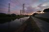 Human footprint on Mother Nature (ah.b|ack) Tags: sony a7ii a7mk2 cosina voigtlander super wideheliar 15mm f45 aspherical iii vm electric tower sunrise urban city nature