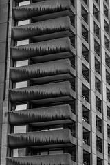 Cantilevered (subterraneancarsickblues) Tags: london cityoflondon squaremile city urban bw blackandwhite barbican barbicanestate towerblock highrise balcony brutalist modernist architecture building canon rebelt2i eos550d kissx4digital sigma18250mm