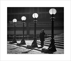 Lamp light (tkimages2011) Tags: shadows lamp street liverpool lime cobbles steps backlight backlit mono monochrome man person buildings sun stgeorgeshall lamppost