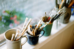 my sister's paint brushes (.grux.) Tags: asahipentaxsv helios44258mmf2 m42 film fujicolor100 expiredfilm sunnyf16 window windowsill cups paintbrushes naturallight painter gravenhurst