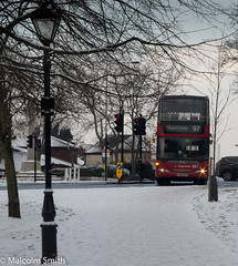 Route 97 Snow (M C Smith) Tags: route 97 scania red bus pentax k3 snow lamps trafficlights road trees grass branches sky grey memorial war car black yellow blue signs numbers letters symbols lights orange railings buildings hedges busstop busshelter chingford