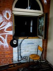 The Burglary (Steve Taylor (Photography)) Tags: burglary burglar ajs sack loot broken smashed leg architecture graffiti streetart window chair black brown white brick newzealand nz southisland canterbury christchurch cbd city