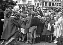 Handing over their children to the custody of the police on the annual summer break for those of the city's children who were not on holiday (theirhistory) Tags: children kids boys girls group parents coach coat dress shirt jumper socks shoes wellies boots