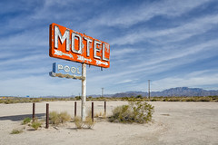 motel / pool / route 66. yucca, az. 2014. (eyetwist) Tags: eyetwistkevinballuff eyetwist motel pool arrow desert sign yucca arizona az route66 abandoned derelict weathered rusty peeling gone type typography typographic nikkor nikon d7000 mojavedesert arid mojave highdesert 1024mmf3545g 1024mm photoshop plugin processed nik color efex nikcolorefex contrast saturated vintage signgeeks waves water dry bulldozed diesel whiting bros whitingbros frontage gas gasoline service station american west landscape vanished roadsideamerica americana americantypologies