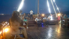 Music to cruise by (Roving I) Tags: musicians evening guitars violins strings boats timber wood decks masts rigging bays travel tourism mice drinks experiences activities lifestyle leisure nhatrang vietnam emperorcruises