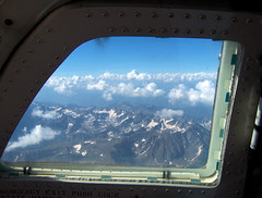 window to the Rocks (Jaws300) Tags: americanchecktransport unitedstates flyingscenery fromabove rockymountains rocks rocky mountains mountain hill hills snow snowy snowcaps scattered cloud clouds cloudlayer layer freight freighter cargo therocks west us usa united states america westernus arial landscape prop propeller plane commuter regional mu2 mu2b mu2b60 act winter flying scenery from above airborne aloft window cockpit american check transport mitsubishi co colorado denver seat windowseat outthewindow ut utah feeder route feederroute weather cloudy hp hpphotosmart emergency exit emergencyexit