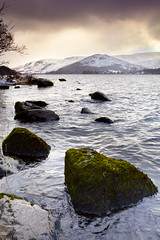 Sunrise in Winter (Benjamin Driver) Tags: ullswater lake lakeullswater lakedistrict district water winter snow sun rise sunrise 2018 waterscape scape landscape land landscapes england rock rocks hills hill snowcapped cloud clouds colour color colours green orange vibrant vivid saturated uk unitedkingdom moss texture cumbria