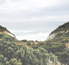 Valley Views (Bron.Wolff) Tags: land landscape nature sea ocean seascape foliage shrubs sky faded muted valley cliffs water waves