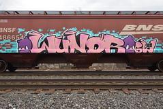 WUNDR (TheGraffitiHunters) Tags: graffiti graff spray paint street art colorful freight train tracks benching benched wundr character hopper