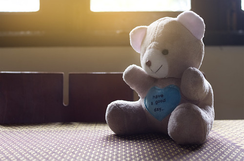 Alone teddy bear sitting on table, Sad concept.