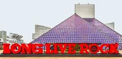 Rock On! (Wes Iversen) Tags: firstenergystadium longliverock nikkor18300mm rockroll rockrollhalloffame architecture colorful digitalart edges geometries pyramid red signs cleveland ohio rockandrollhalloffame