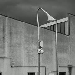 Flamingo shaped white street light, warehouse, stormy sky. B&W ( Esplorazione urbana/urban exploration) (sandroraffini) Tags: urban fragment sony rx100m1 bw street light flamingo slazzaro bologna sandroraffini stormy sky white exploration details abstract nuova oggettività reality prospettive minimalismo minimalism cronico chronic