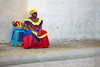 colorful woman in Cartagena (ABWphoto!) Tags: southamerica colombia cartagena oneperson people onewoman sitting colorful fruit street wall ethnic cultural
