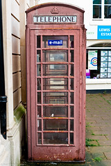 Times change. (Neil. Moralee) Tags: neilmoralee teignmouth2016neilmoralee telepphone box telephonebox phonebox red email old faded teignmouth devon uk derelict paint phone neil moralee nikon colour color street british telecom bt d7100