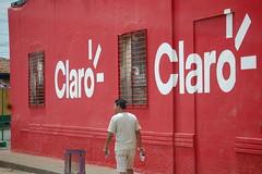 Claro (Midnight Believer) Tags: rivasnicaragua claro business building pedestrian candid urban travel latinamerica centralamerica