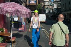 Old Compton Street, 2006 (David Solomons) Tags: music london uw hat fashion umbrella streetphotography piercing headphones ip2 davidsolomons