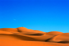 Dunes (Guillaume Bertocchi) Tags: travel blue orange nature landscape sand topf50 topf75 desert feminine quality dune curves topc100 morocco maroc interestingness9 outstandingshots specland