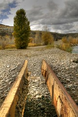 The Same? (HDR) (skyscraper2290) Tags: road bridge detail tree clouds canon river outdoors rocks hdr jacksonhole inthewest jacksonholewyoming
