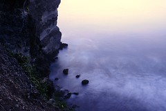 batu (Farl) Tags: longexposure travel sea bali cliff heritage indonesia rocks surf waves dusk indianocean blues uluwatu jimbaran postsunset