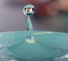 Droplets with reflection Image (dawey [Mohammad Alhameed]) Tags: blue macro reflection water droplets canon20d drop droplet tap  dripping canon100macro vwc  anawesomeshot  kuwaitvoluntaryworkcenter  photovwc kuwaitvwc