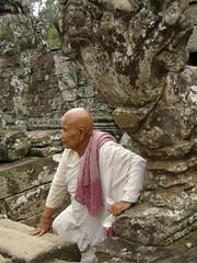 Buddhist Nun at The Bayon (Ian Campsall) Tags: face stone temple asia cambodia vishnu faces angkorwat nun holy angkor wat bayon thebiggestgroup httpiancampsallsmugmugcom