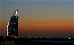 ..     !! (Miss Art) Tags: blue light sunset sea orange moon building art skyline night canon lights dubai uae crescent arab burjalarab canon350d burj aplusphoto