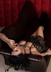 tease. (Liz Lieu) Tags: liz leather diamonds couch robertocavalli lieu leatherboots lizlieu pokerdiva yourthebiggesttease