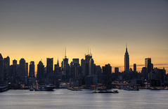 Dawn in New York (nicoatridge) Tags: nyc morning light usa ny newyork water beautiful silhouette skyline sunrise river dawn boat newjersey amazing ship manhattan nj midtown esb excellent intrepid manhattanskyline empirestatebuilding empirestate hudson chrysler westsidehighway barge hdr highdynamicrange weehawken joedimaggiohighway hudsoncounty ussintrepid chryslertower enchanting hamiltonpark tonemapped tonemapping tonemap bagelstore citythatneversleeps ny9a firstonflickr acitythatneversleeps nicoatridge first200loaded