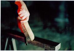 hand down brush red (orangetortoise) Tags: wire hand labor grab grasp