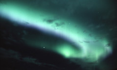 Aurora 3: Sweeping Arc (storm light) Tags: sky canada green stars glow bc violet oxygen fluorescent midnight planet curtains rays nitrogen luminous arcs atmospheric atoms northernlights auroraborealis molecules phenomenon electrons magneticfield ionosphere toadriver solarelectrons magneticpoles auroraloval