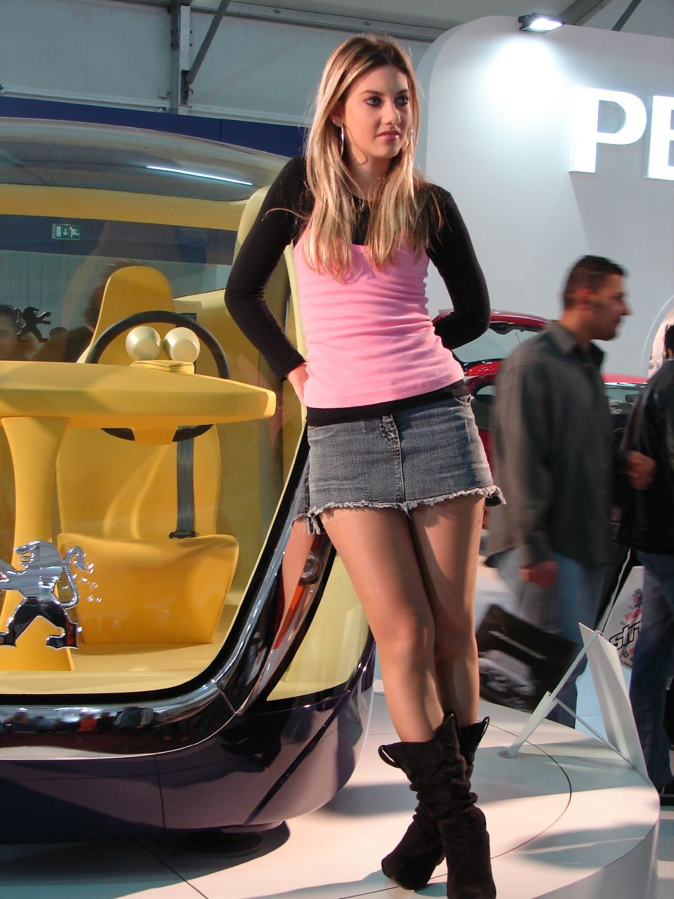 Sexy auto show girl with mini skirt