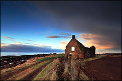 Old Cottage - Fife (angus clyne) Tags: road old uk roof light sunset red wild cloud sun white seascape storm black art fall beach window nature water pool rain rock stone wall canon fence dark lens landscape gold golden coast scotland boat still interesting wire sand track day village open angle post harbour fife path decay magic wide cottage ruin dream picture scottish dry front explore soil photograph page frame worn sail rest cave standrews crumble moment setting barbed northeastwestsouth boarhills bluegreenyellowgold